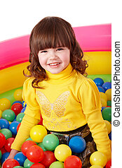 Happy child in group colourful ball.