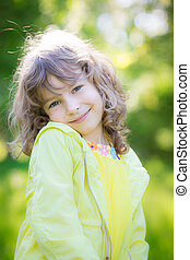 Happy child in spring park