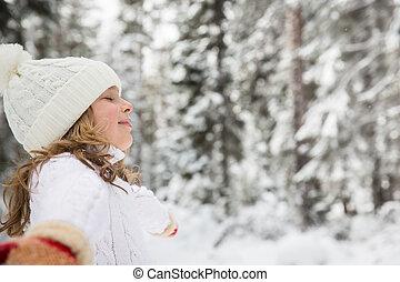 Happy child in winter park