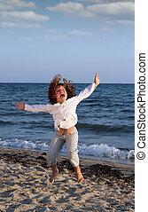 happy child jumping on beach