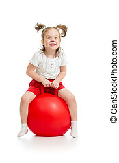 happy child jumping on bouncing ball - Happy child jumping...
