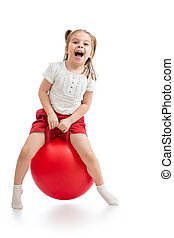 happy child jumping on bouncing ball. Isolated on white.