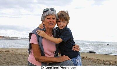 Happy child kissing grandmother