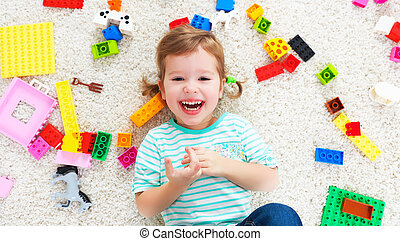 happy child laughing and playing with toys constructor -...