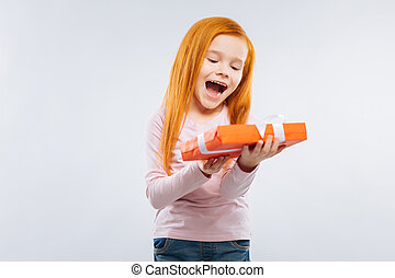 Happy child looking at gift box