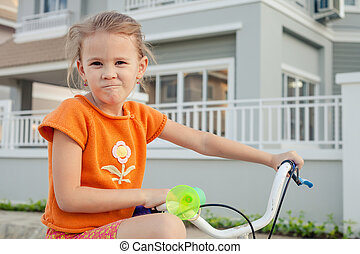 happy child on a bicycle