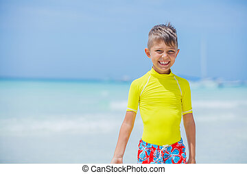 Happy child on beach. Summer vacation concept