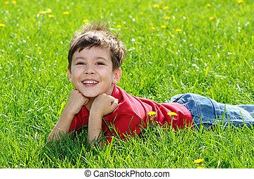 Happy child on green grass