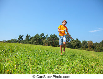 Happy child on sunny meadow outdoors