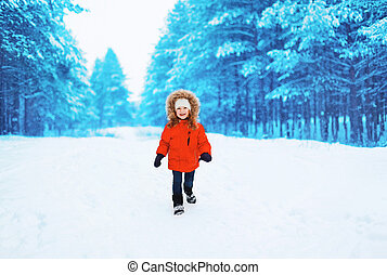 Happy child outdoors in winter snowy day
