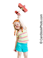 happy child pilot and playing with wooden airplane toy
