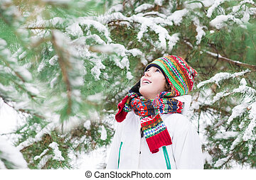 Happy child playing in a snowy forest