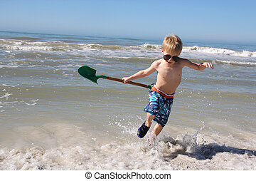 Happy Child PLaying in the Ocean Waves