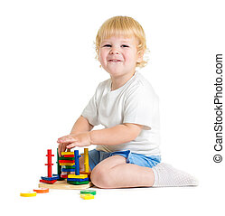 Happy child playing logical educational toys
