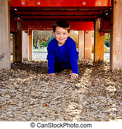 Happy child playing on playground