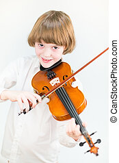 Happy child playing violin