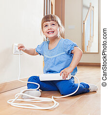 Happy child playing with electricity at home