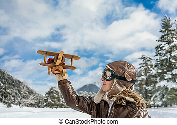 Happy child playing with toy airplane
