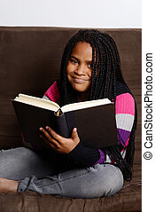 happy child reading a book