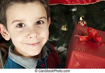 Happy child receive the gift of Christmas