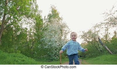 Happy child running on the path in park