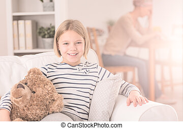 Happy child sitting on sofa