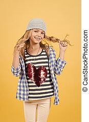 Happy child smiling with long blond hair, beauty