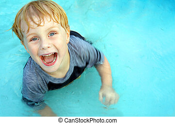 Happy Child Swimming in Pool