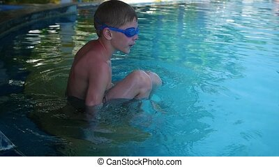 happy child swims with enjoyment under the water in the pool