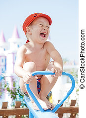 Happy child swinging on a swing