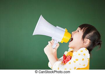 happy child  using a megaphone with blackboard