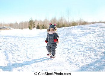 Happy child walking in sunny winter day