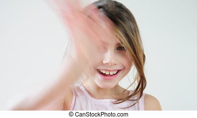 happy child waving good-bye and blowing kisses