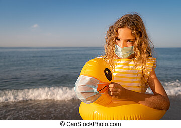 Happy child wearing medical mask outdoor