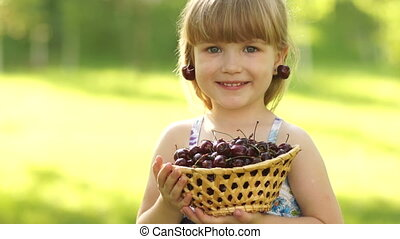 Happy child with a basket of fruit