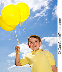 Happy child with balloons