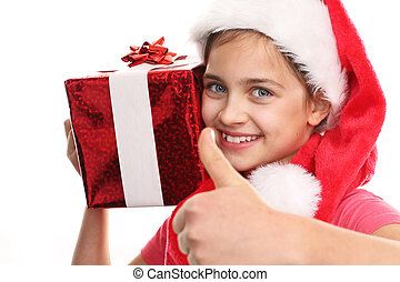 Happy child with Christmas gift.