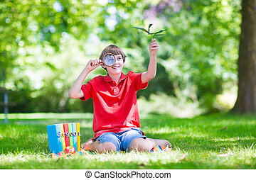 Happy child with magnifying glass