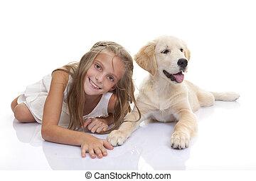 happy child with pet puppy dog