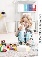Happy childhood despite disease - Small boy doing...