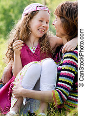 Happy childhood - Mother and daughter have a happy time ...