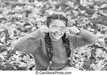 Happy childhood. School time. Autumn leaves and nature. Happy little girl in autumn forest. Small child with autumn leaves. Feeling dry and protected. Going crazy. Feeling totally free