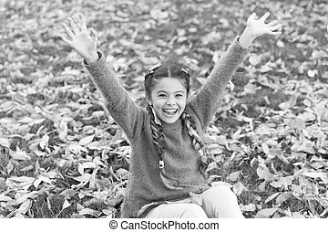 Happy childhood. School time. Autumn leaves and nature. Small child with autumn leaves. Happy little girl in autumn forest. Feeling comfortable. Perfect place to stay. Totally happy
