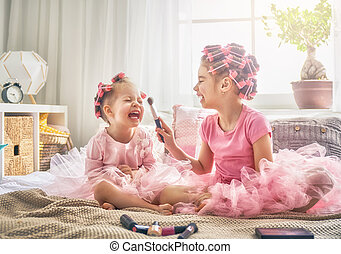 sisters are doing hair and having fun