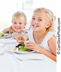 Happy children at the table
