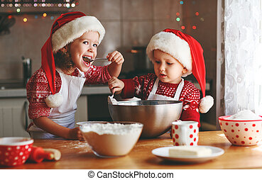 happy children bake christmas cookies - happy funny children...