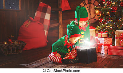 happy children brother and sister elf, helper of Santa with...
