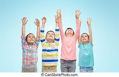 happy children celebrating victory over blue