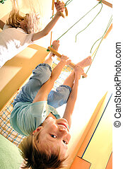 happy children doing sports gymnastics