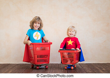 Happy children driving toy car at home